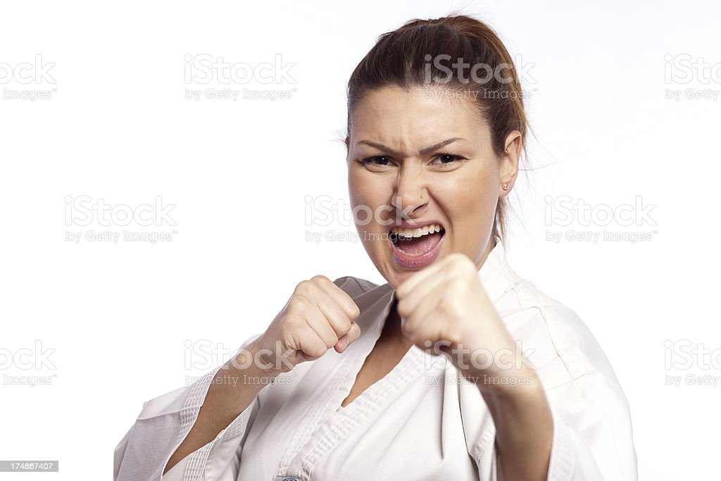 Portrait of a fighting woman making Taekwando royalty-free stock photo