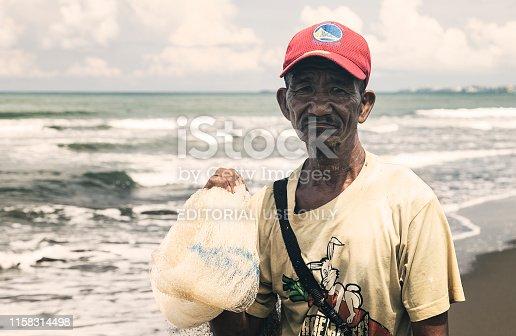 Manila, Philippines - September, 7, 2016: Portrait of a Filipino fisherman at the seaside