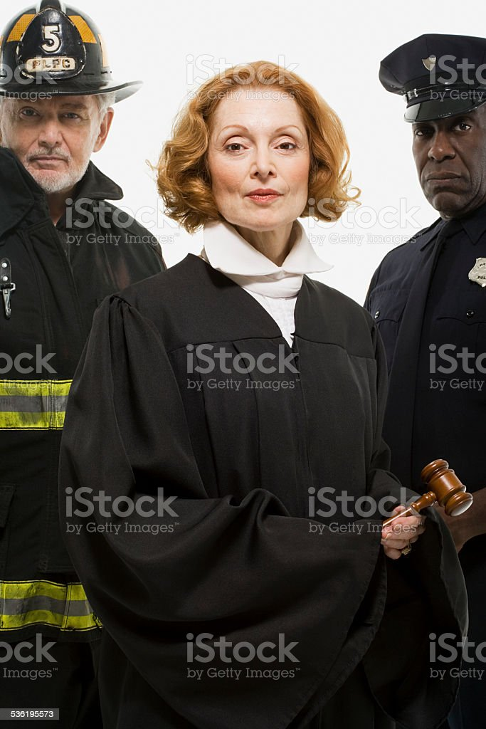 Portrait of a firefighter a judge and a police officer stock photo
