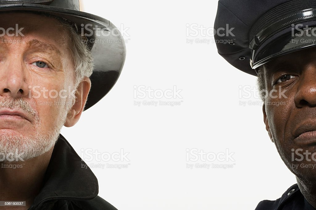 Portrait of a firefighter and a police officer stock photo