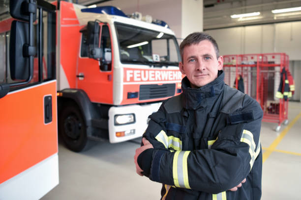 portrait of a firefighter in the operations centre at the fire-fighting vehicle stock photo