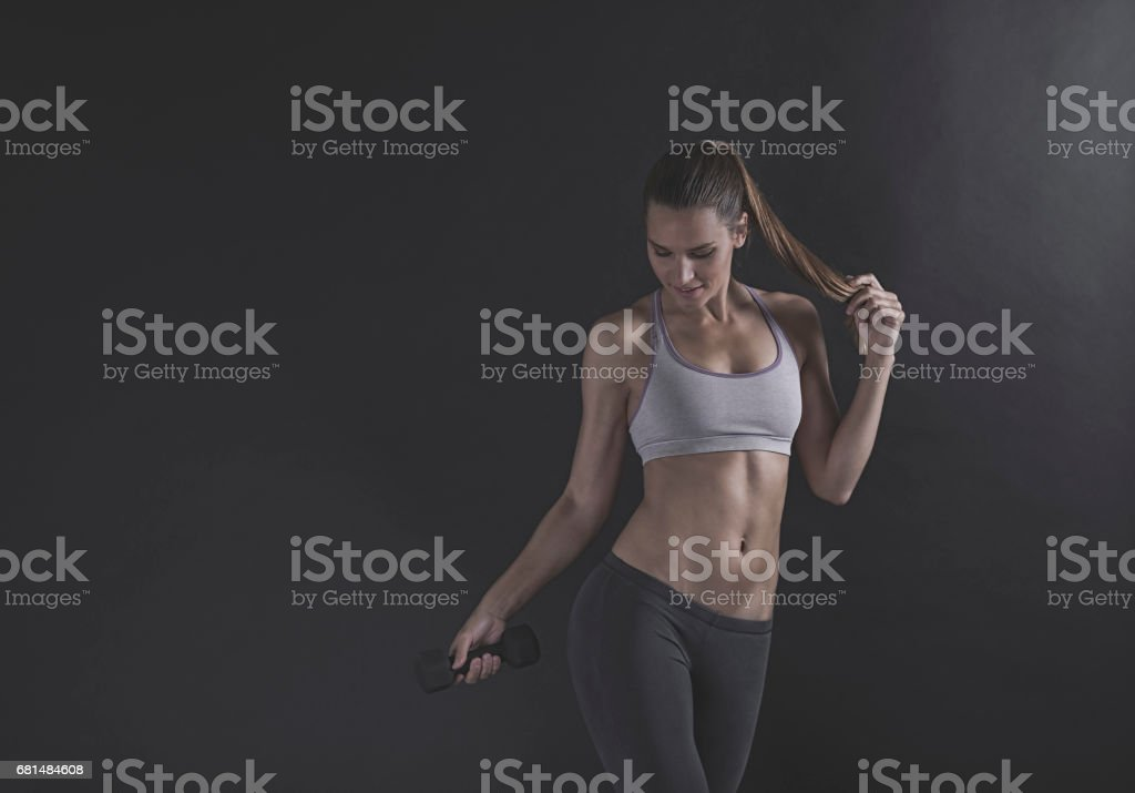 Portrait of a fit and toned  woman wearing a sports bra royalty-free stock photo