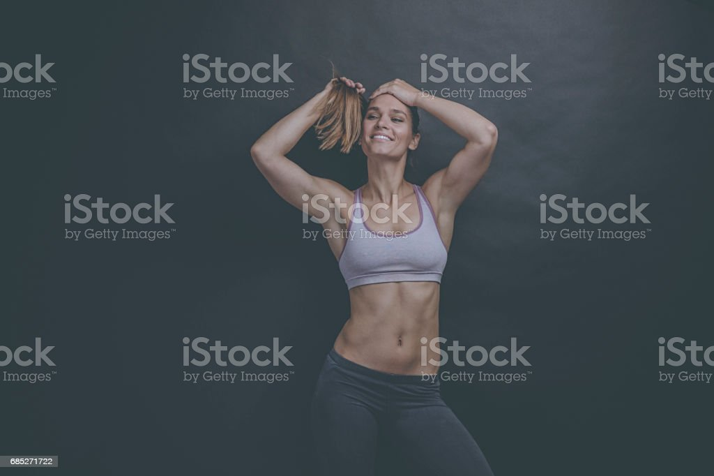Portrait of a fit and toned  woman wearing a sports bra stock photo