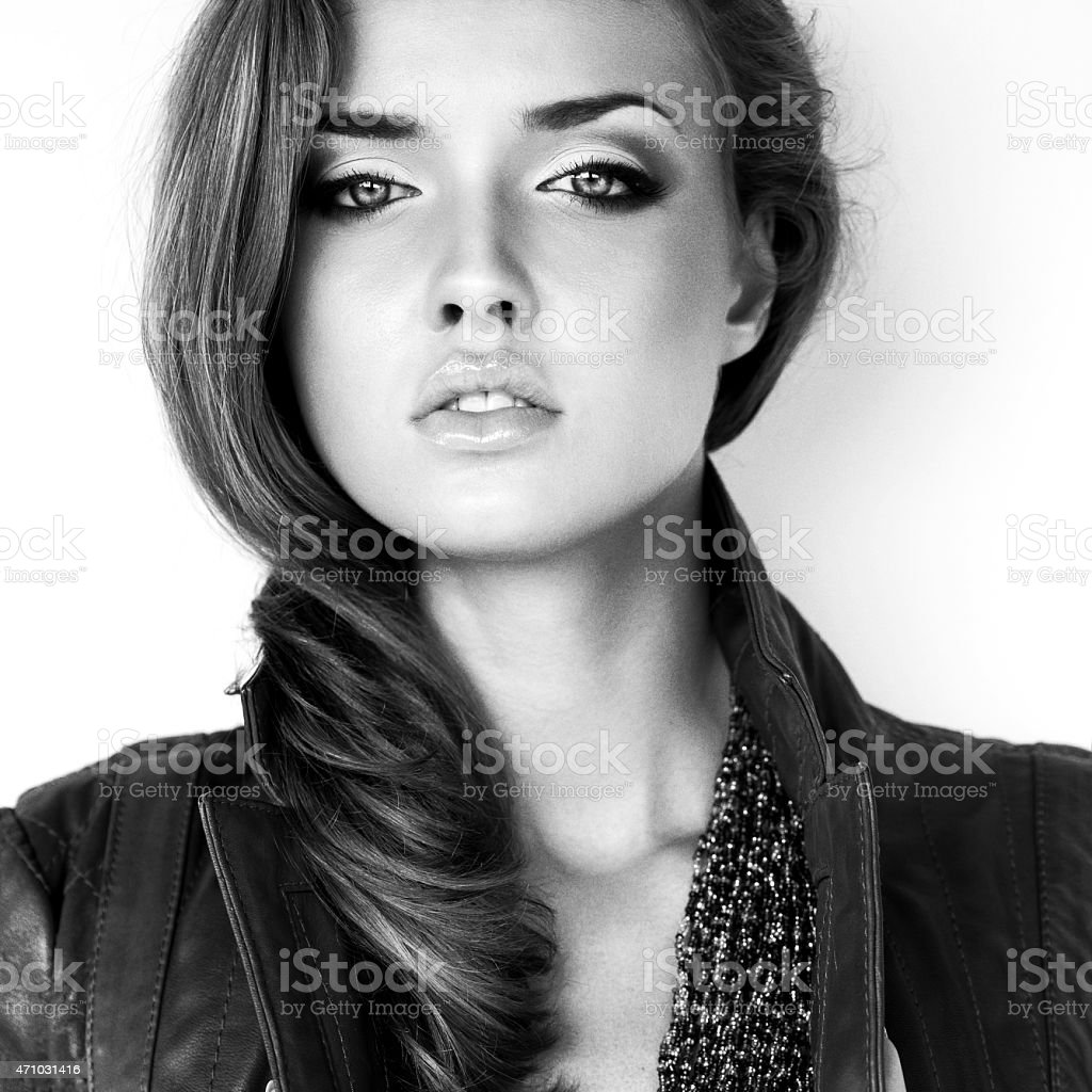 Portrait of a fresh and lovely woman wearing leather jacket Portrait of a fresh and lovely woman wearing leather jacket 20-24 Years Stock Photo