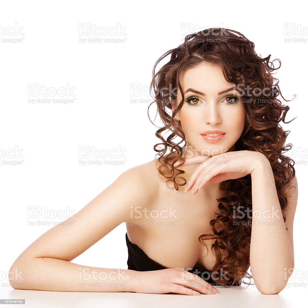 Portrait of a fresh and lovely woman with curls royalty-free stock photo