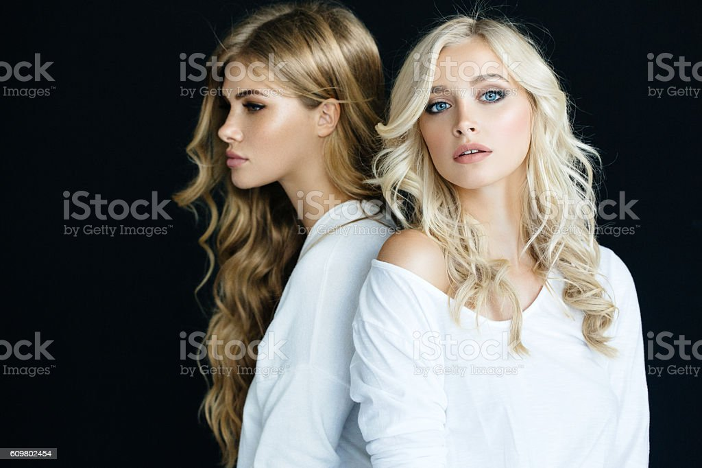 Portrait of a fresh and lovely women on black background stock photo