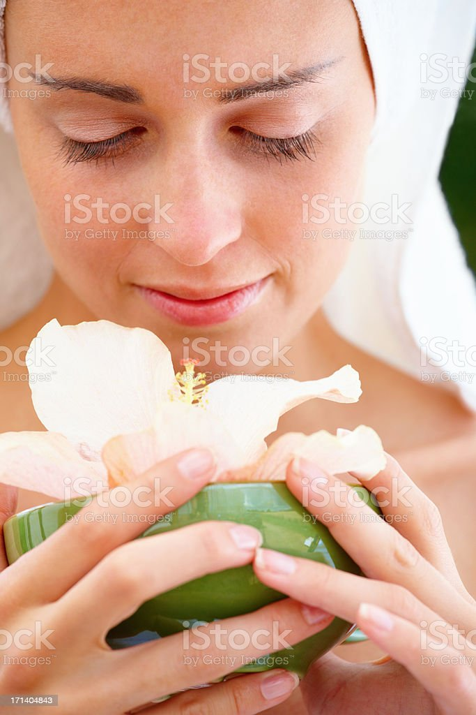 Portrait of a fresh young pretty beautiful woman holding a bowl with a flower royalty-free stock photo