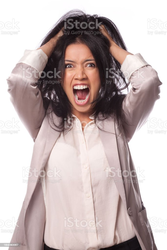 Portrait of a frustrated businesswoman holding her hair up royalty-free stock photo