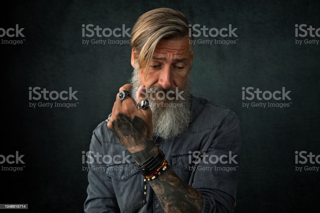Portrait of a frustrated man with a beard stock photo