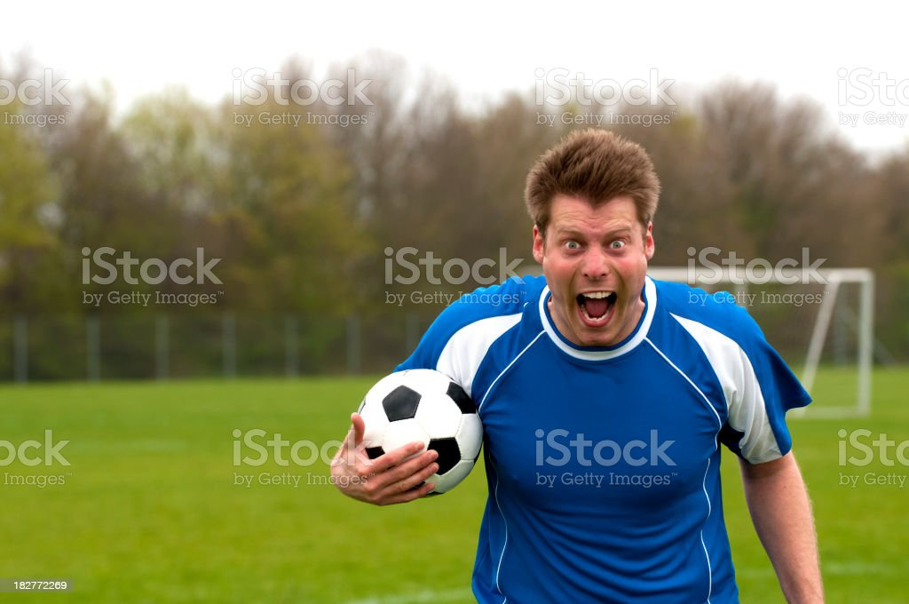 Portrait of a furious soccer player who screams at camera royalty-free stock photo