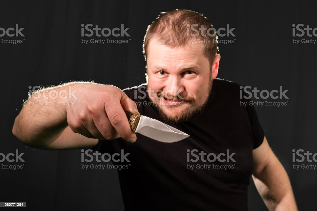 Portrait of a gangster with a knife royalty-free stock photo