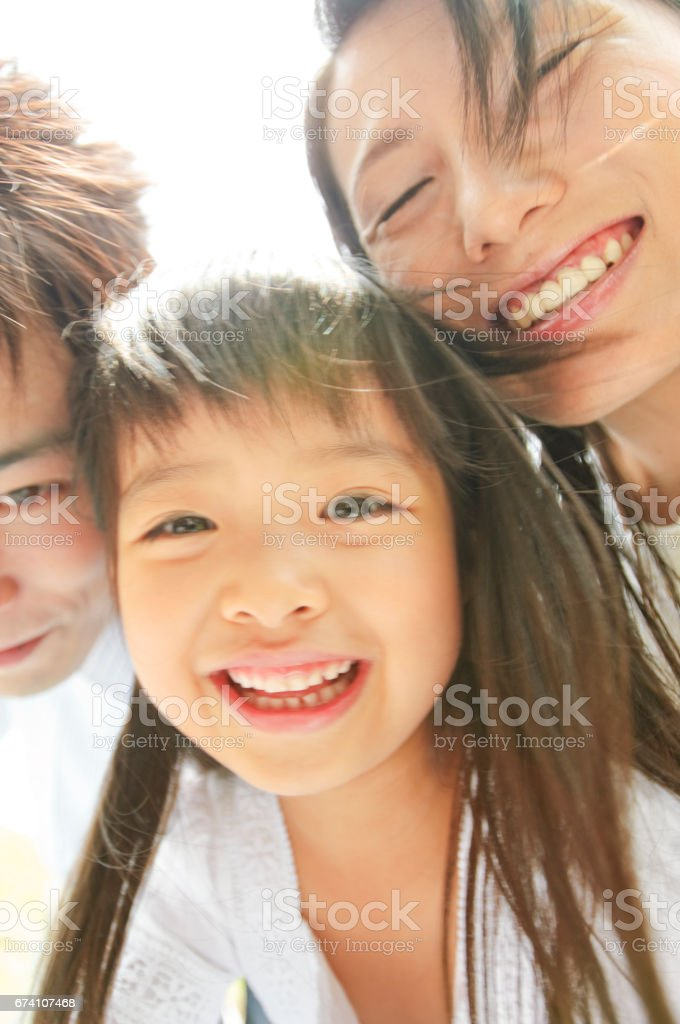 Portrait of a girl and her parents royalty-free stock photo