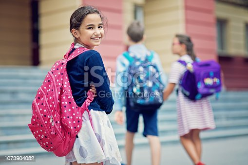 Portrait of a girl entering the school