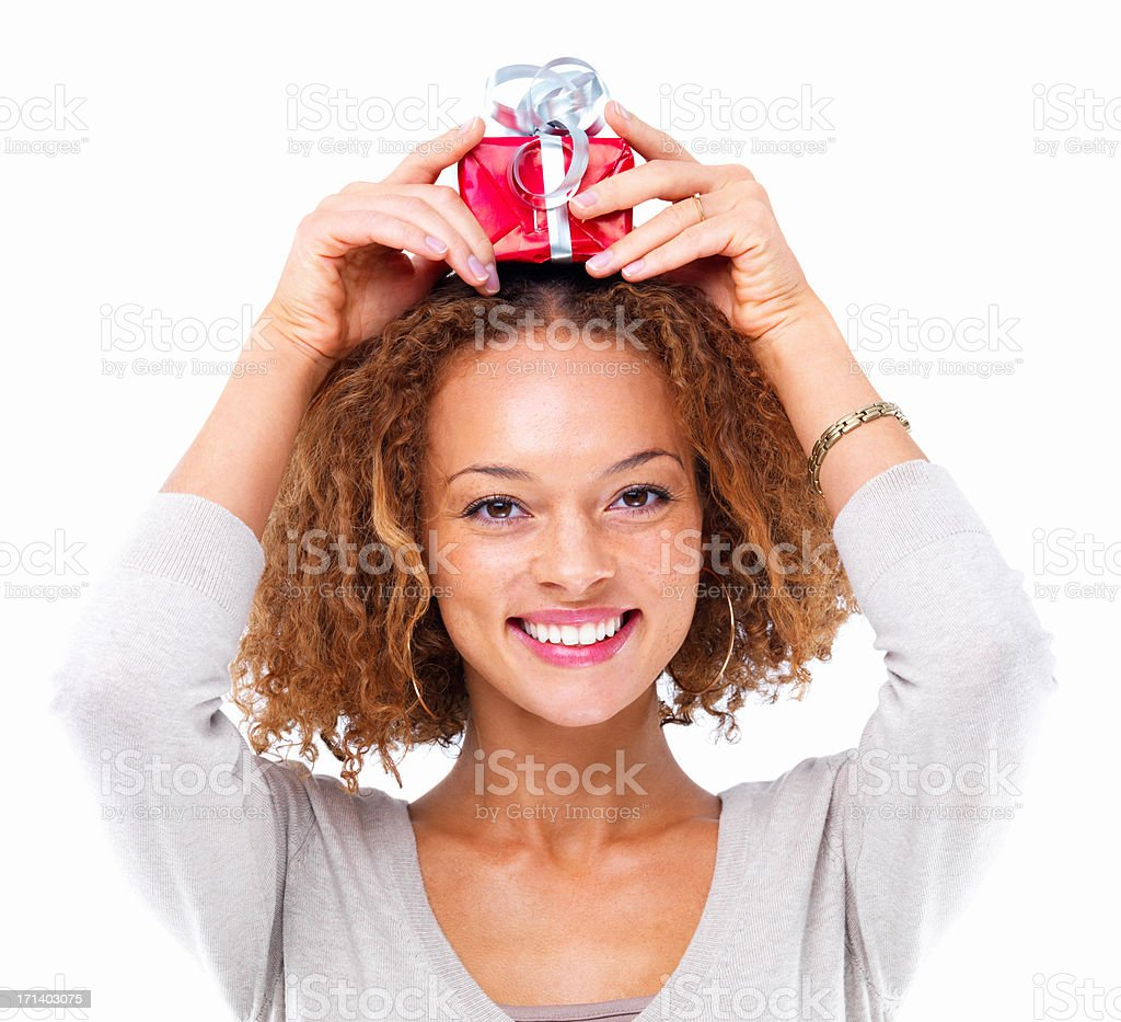 Portrait of a girl holding a gift on head isolated on white background stock photo