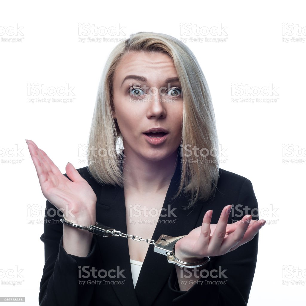 portrait of a girl in handcuffs on a white background stock photo