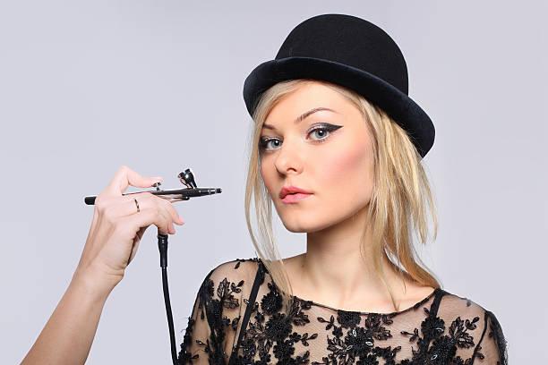 portrait of a girl model with hand airbrush. - airbrush make up stock-fotos und bilder