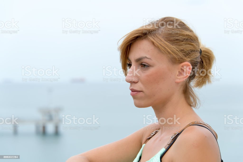Portrait of a girl on the beach. stock photo
