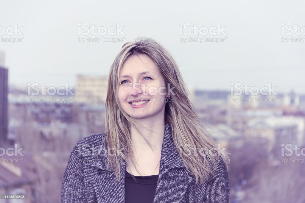 Portrait of a girl on the roof of the building. royalty-free stock photo