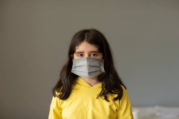 Portrait of a girl wearing a protective mask stock photo