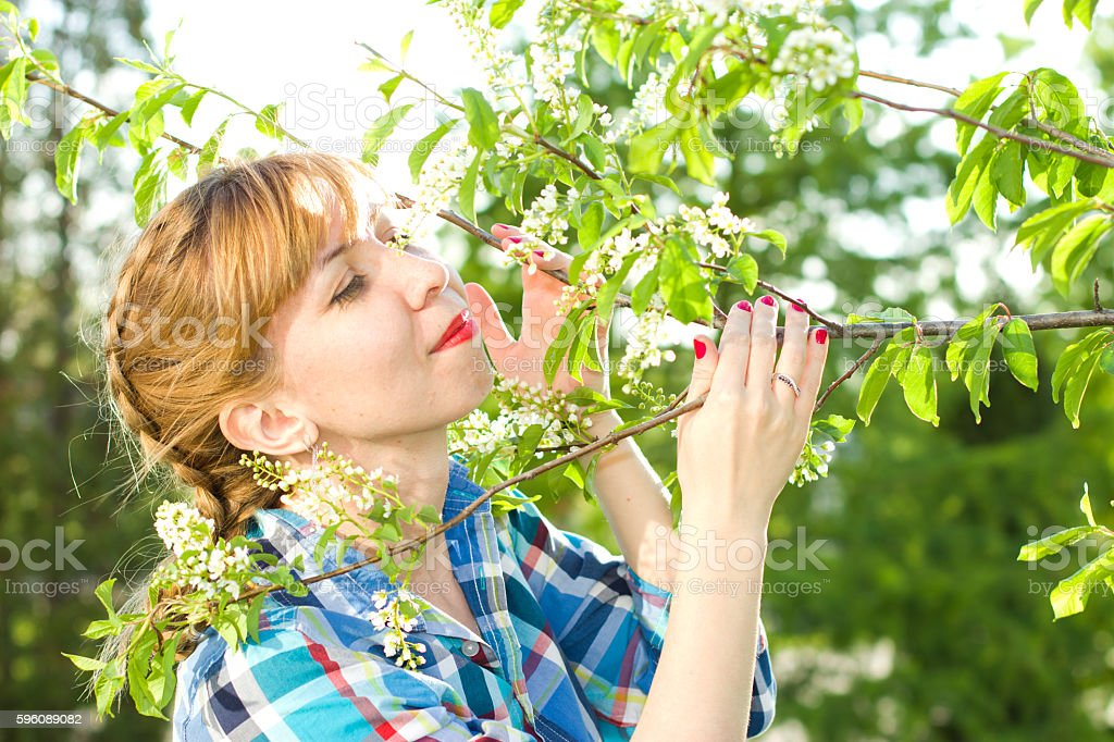 Portrait of a girl with a bird-cherry tree royalty-free stock photo