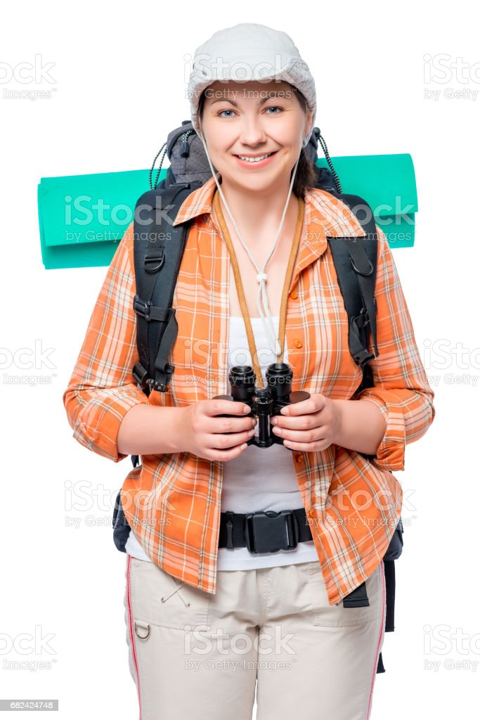 portrait of a girl with a large tourist backpack and binoculars on a white background photo libre de droits