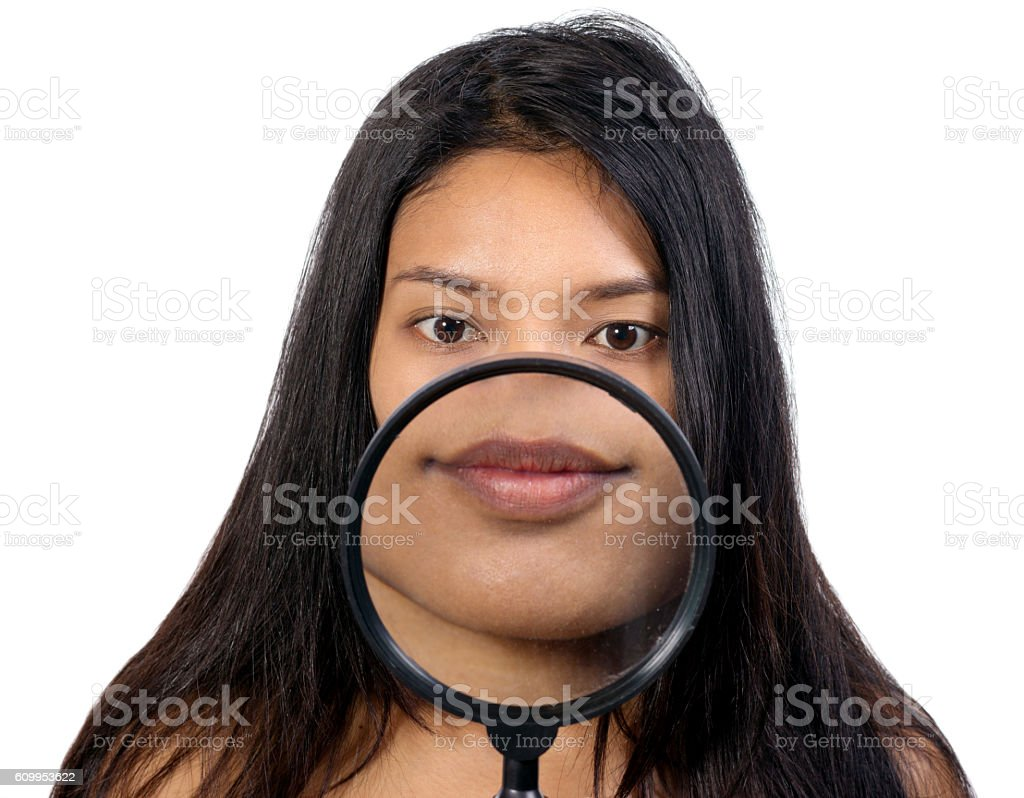 portrait of a girl with a magnifying glass stock photo
