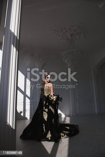 512061362istockphoto Portrait of a girl with a make-up dead man on Halloween. 1165996149