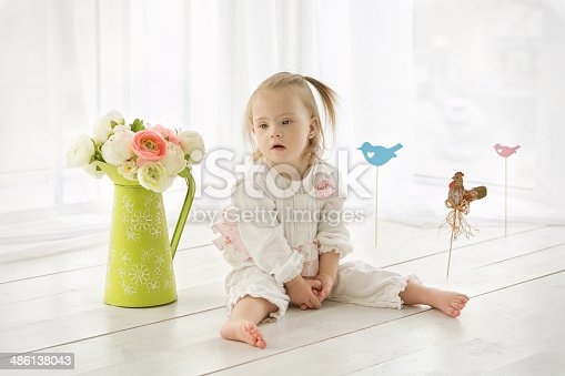 istock portrait of a girl with Down syndrome 486138043