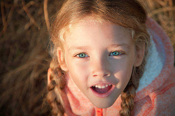 portrait of a girl with pigtails closeup outdoors - pigtails stock photos and pictures