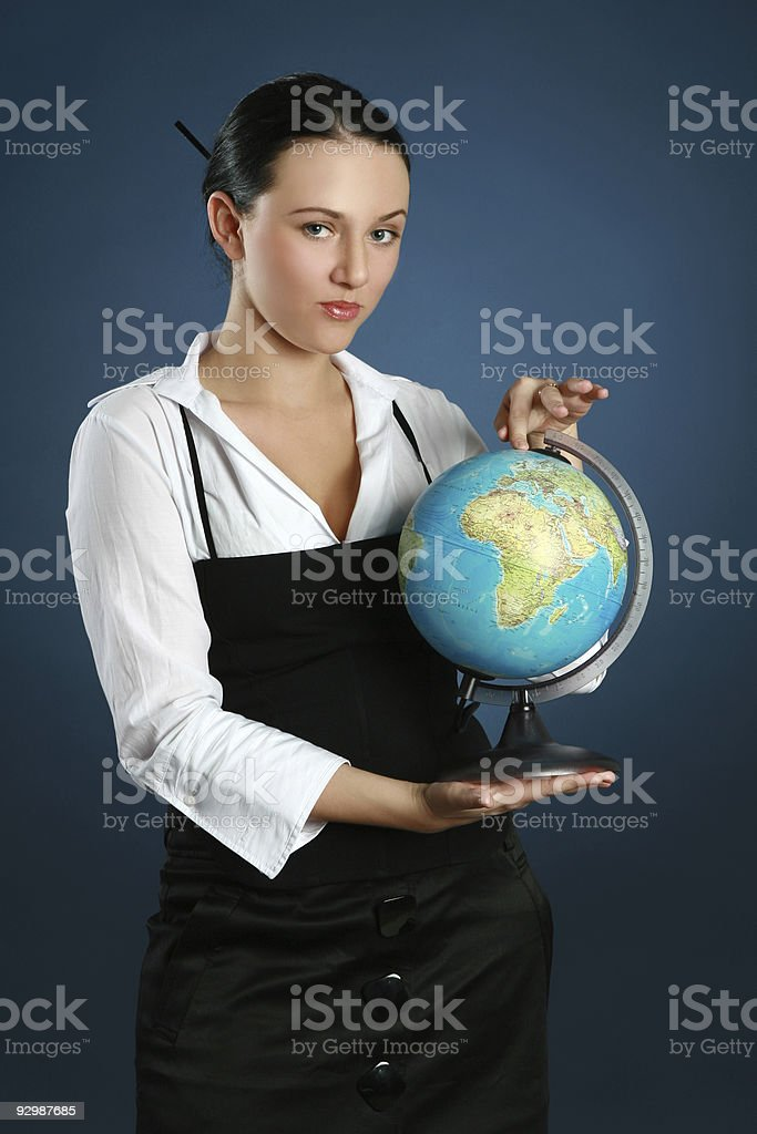 Portrait of a gorgeous brunette with globe royalty-free stock photo