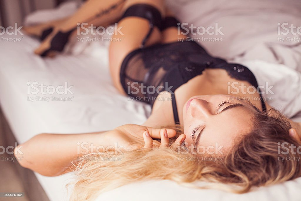 portrait of a gorgeous woman in black seductive underwear stock photo