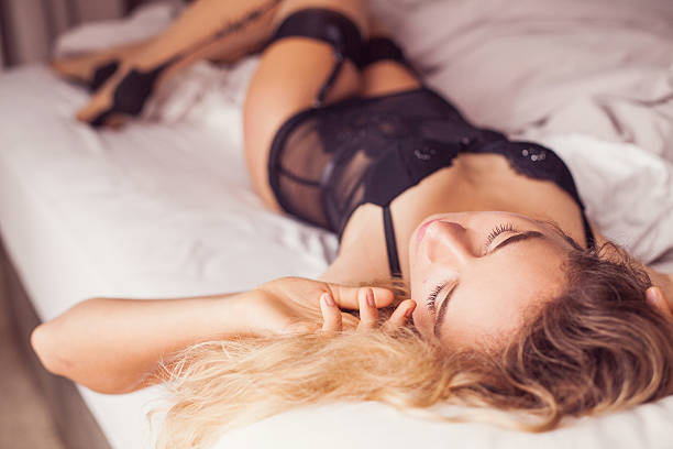 portrait of a gorgeous woman in black seductive underwear - underwear stock photos and pictures