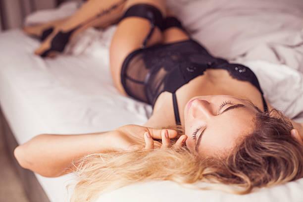 portrait of a gorgeous woman in black seductive underwear stock photo
