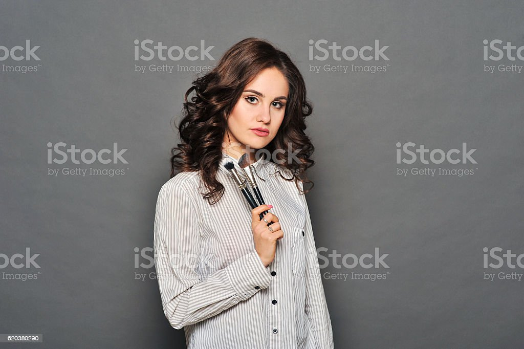 Portrait of a gorgeous young brunette with brush zbiór zdjęć royalty-free