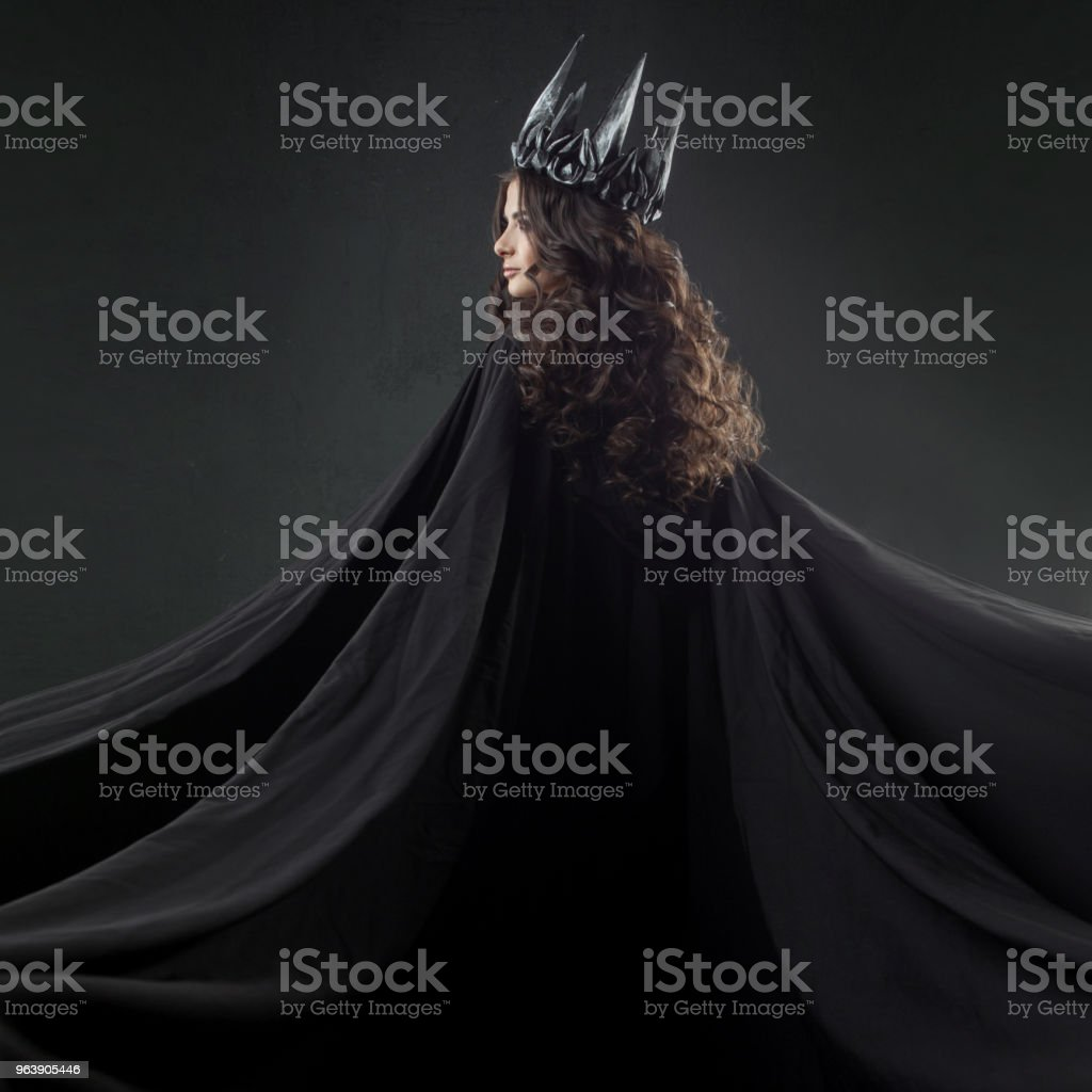 Portrait of a Gothic Princess. Beautiful young brunette woman in metal crown and black cloak. - Royalty-free Adult Stock Photo