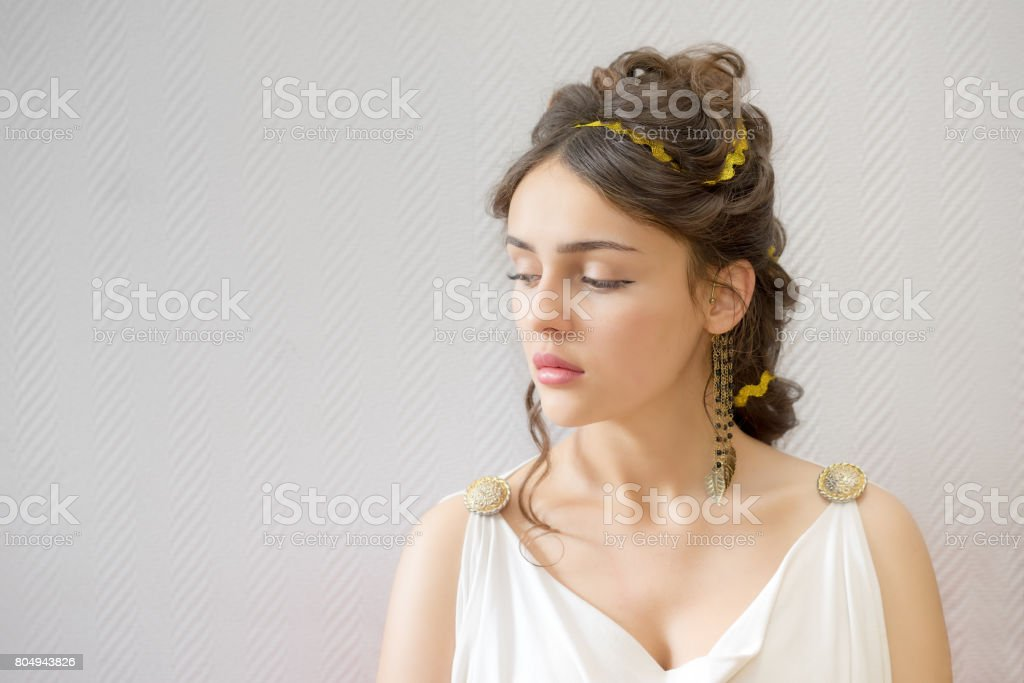portrait of a graceful beautiful greece woman in traditional white tunic closed her eyes with copy space stock photo