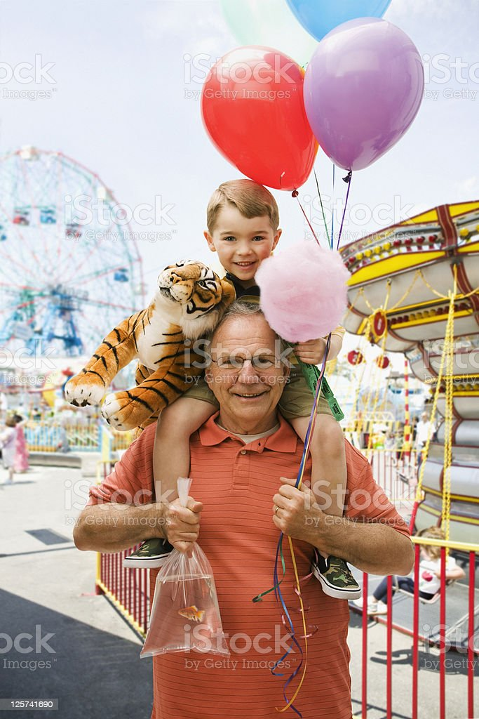 Portrait of a Grandfather and Grandson in a Fair stock photo