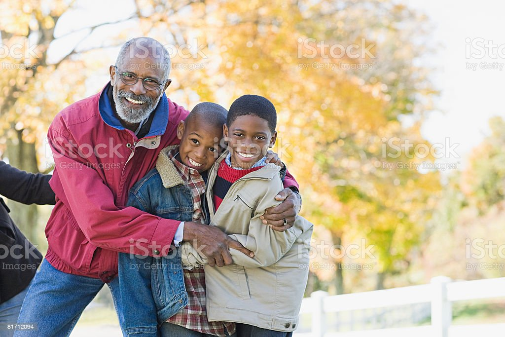 Portrait of a grandfather and grandsons stock photo