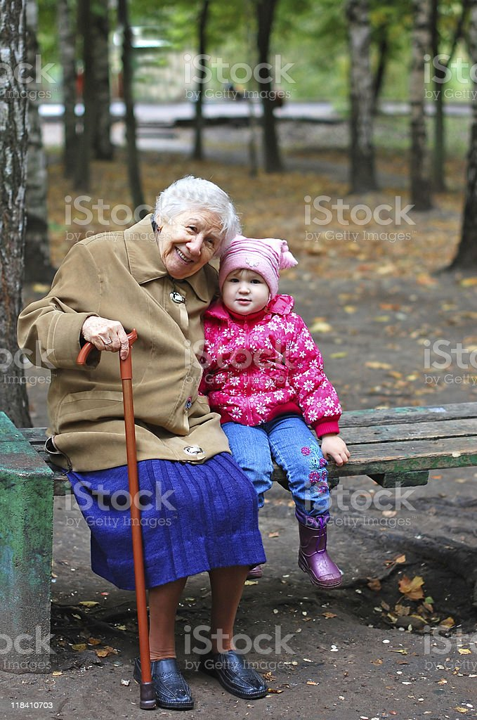 portrait of a grandmother and granddaughter in the garden royalty-free stock photo