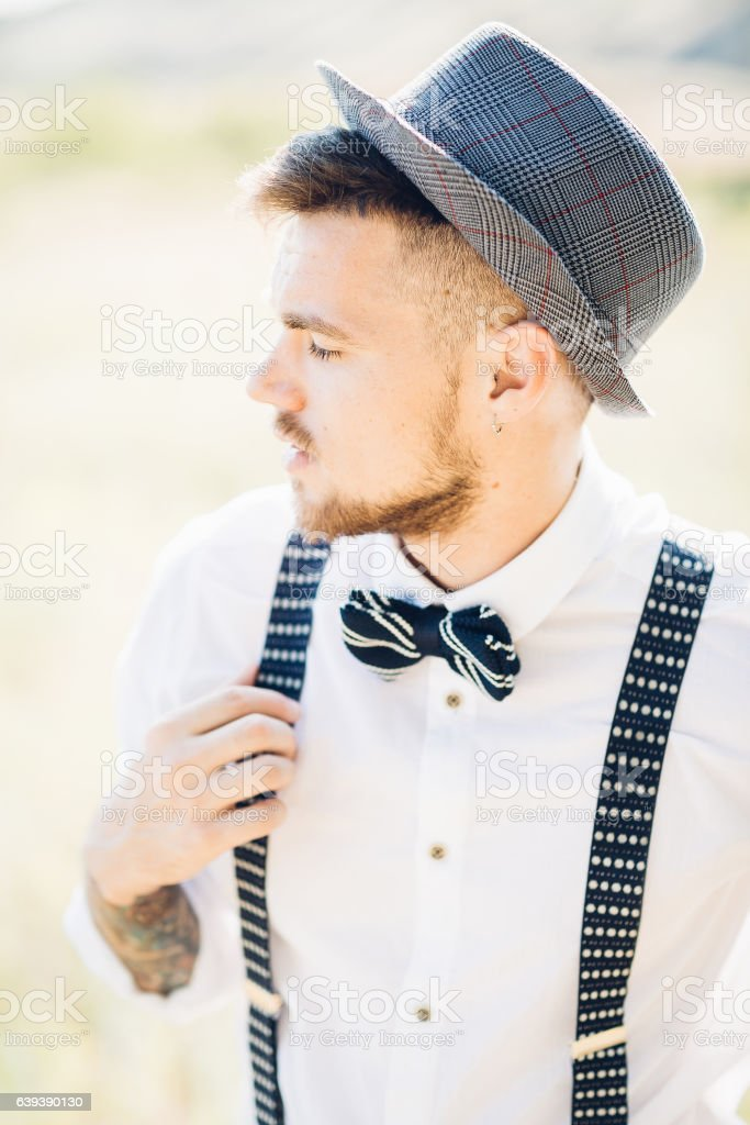 portrait of a groom in  bow tie at the wedding - Photo