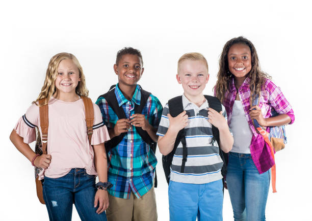 Portrait of a Group of smiling elementary school students with backpacks stock photo