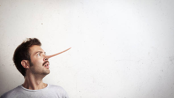 Portrait of a guy with long nose Conceptual portrait of a liar pinocchio stock pictures, royalty-free photos & images
