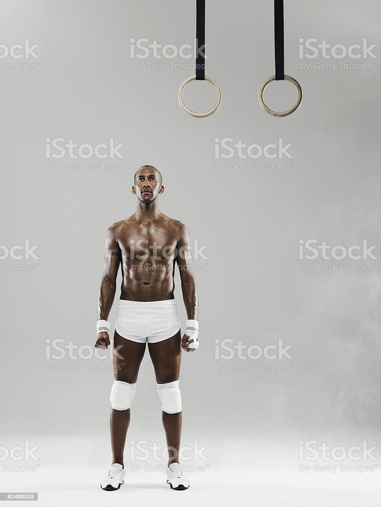 Portrait of a gymnast and gymnastic rings 免版稅 stock photo