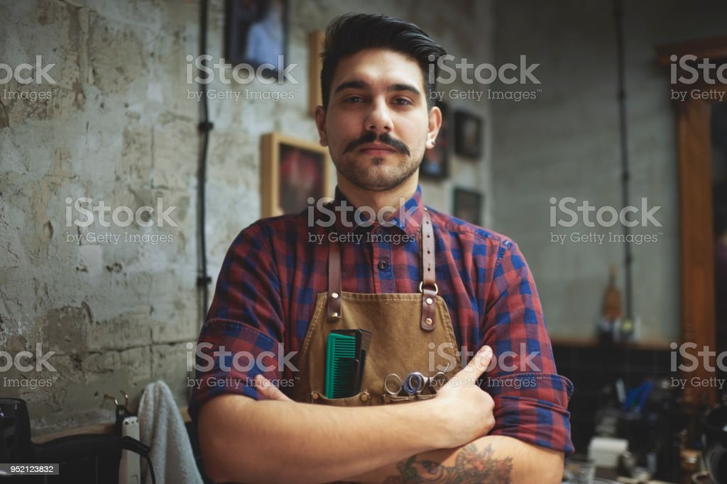 Portrait of a hairdresser in barber shop stock photo