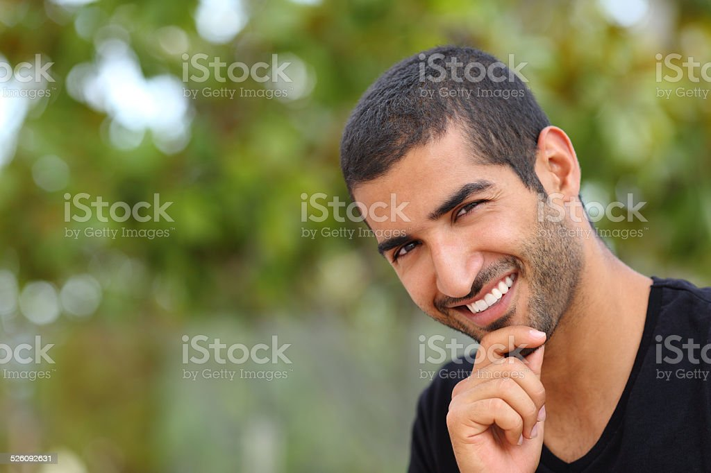 Portrait of a handsome arab man face outdoors stock photo