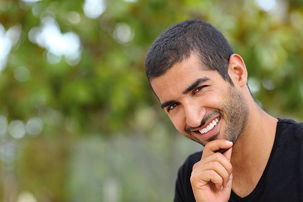portrait of a handsome arab man face outdoors - north africa stock photos and pictures