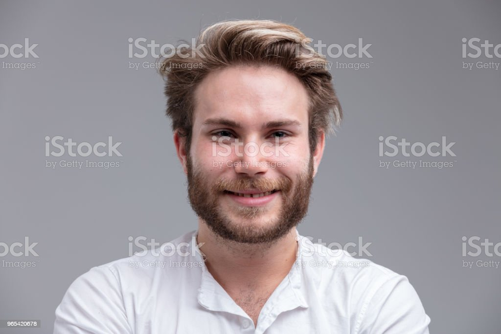 Portrait of a handsome blond young man smiling zbiór zdjęć royalty-free