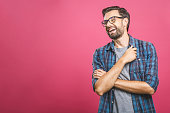 istock Portrait of a handsome casual man who laughs, standing and laughing over pink background 1162970147