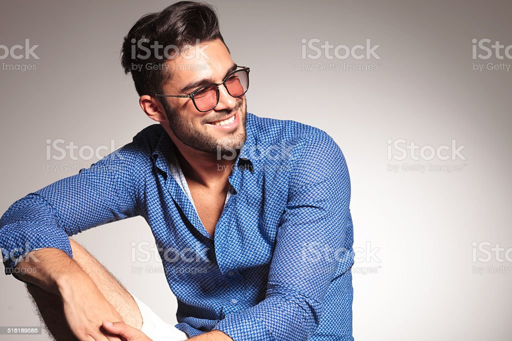 Portrait of a handsome fashion man smiling stock photo