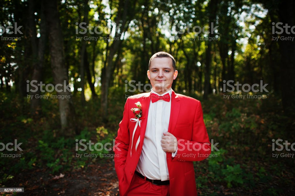 portrait-of-a-handsome-groom-in-red-tuxe